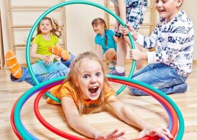 Emotional kids having fun in gym